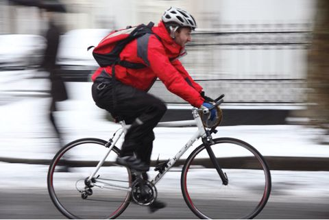 Cyclist riding road bike in cold weather