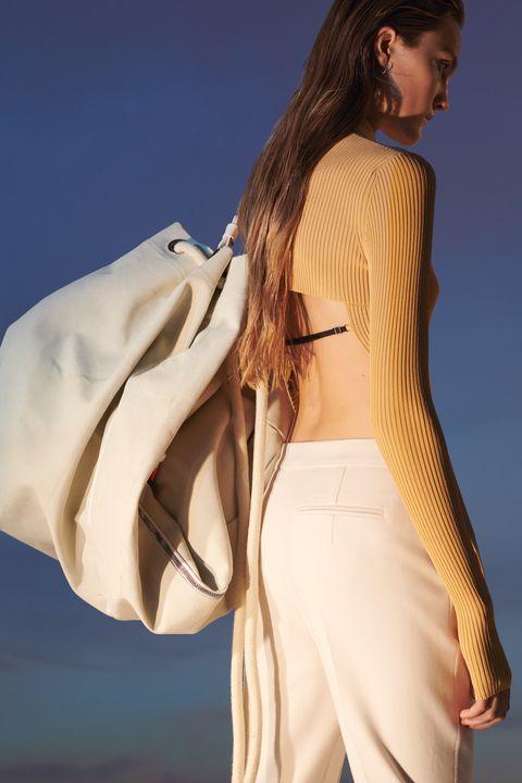 Sleeve, Shoulder, Joint, Style, Fashion, Neck, Fashion model, Waist, Model, Beige,