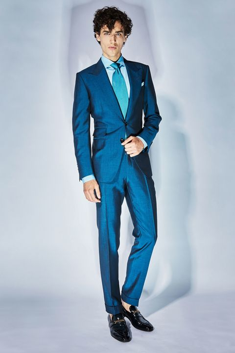 Suit, Clothing, Blue, Formal wear, Fashion model, Tuxedo, Fashion, Standing, Electric blue, Outerwear,