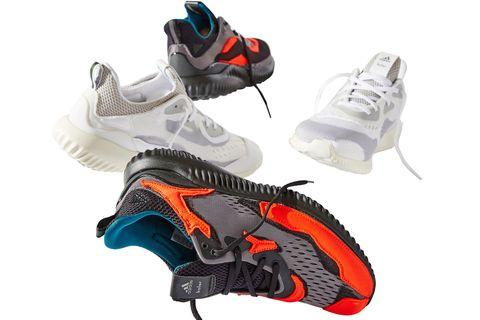 Footwear, Shoe, Running shoe, Orange, Athletic shoe, Outdoor shoe, Sneakers, Skate guard, Sportswear, Walking shoe,