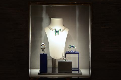 Light, Lighting, Vase, Mannequin, Glass, Room, Display case, Interior design, Light fixture, Art,