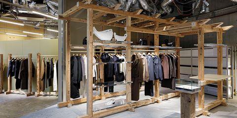 Textile, Room, Clothes hanger, Outlet store, Beige, Khaki, Collection, Boutique, Retail, Fashion design,
