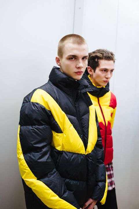 Yellow, Clothing, Jacket, Outerwear, Personal protective equipment, Workwear, Hood, Lifejacket,