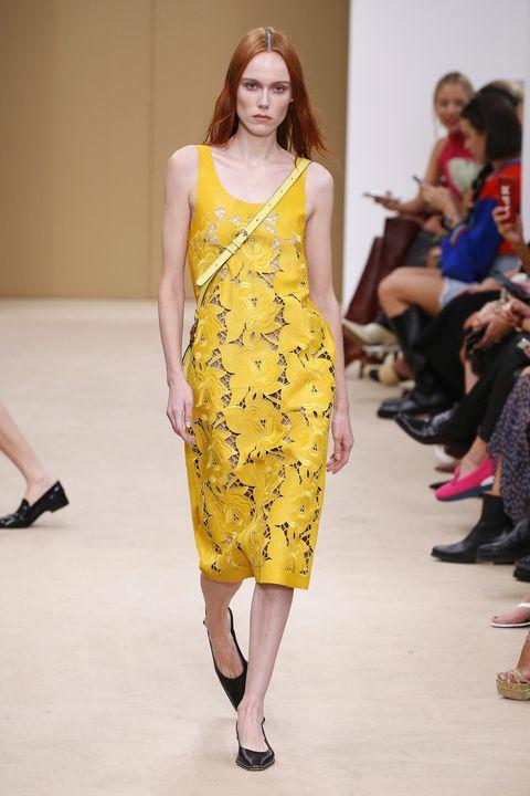 Fashion show, Fashion model, Runway, Fashion, Clothing, Yellow, Dress, Fashion design, Shoulder, Public event,