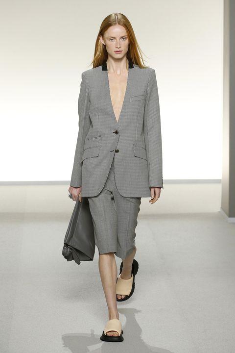 Clothing, Fashion model, Fashion show, Fashion, Runway, Outerwear, Suit, Shoulder, Blazer, Formal wear,