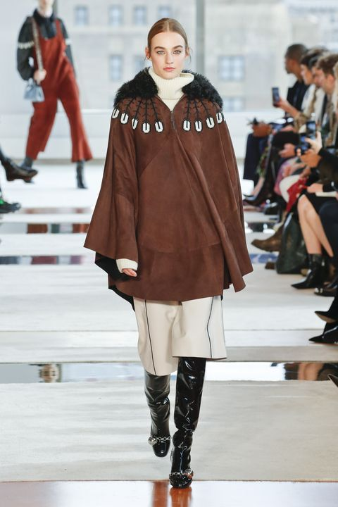 Fashion model, Fashion, Runway, Fashion show, Clothing, Outerwear, Brown, Footwear, Joint, Shoulder,