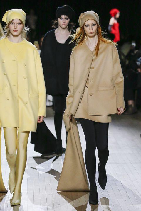 Fashion model, Fashion, Fashion show, Clothing, Runway, Outerwear, Event, Footwear, Human, Headgear,