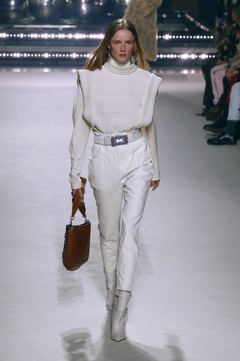 Fashion model, Fashion show, Fashion, White, Runway, Clothing, Shoulder, Fashion design, Jeans, Human,