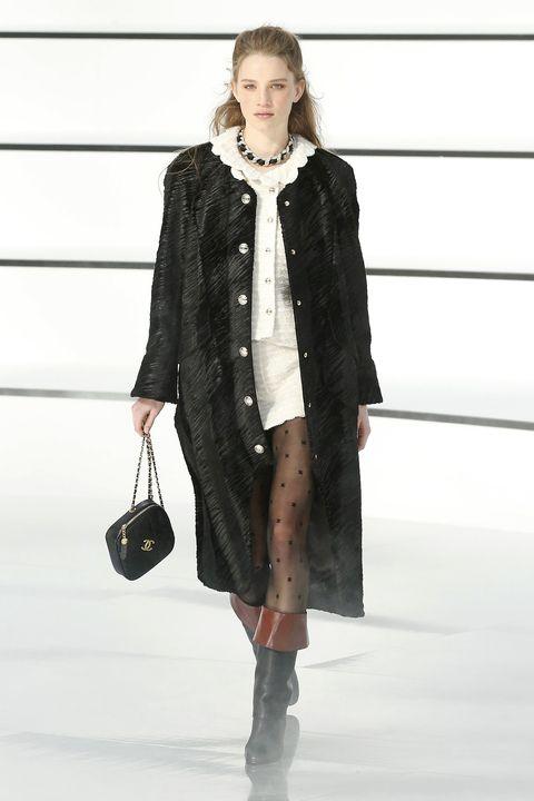 Fashion show, Clothing, Fashion, Fashion model, Runway, Outerwear, Coat, Overcoat, Footwear, Street fashion,
