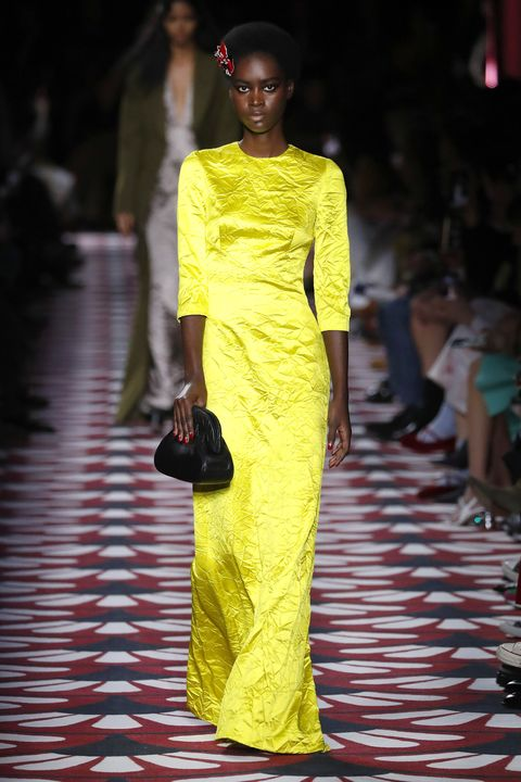Fashion model, Fashion, Runway, Fashion show, Yellow, Clothing, Fashion design, Haute couture, Dress, Shoulder,