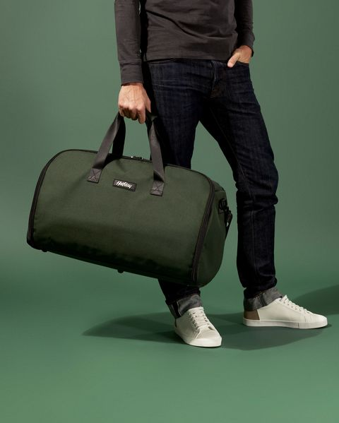 Bag, Baggage, Green, Hand luggage, Suitcase, Briefcase, Luggage and bags, Leg, Footwear, Satchel,