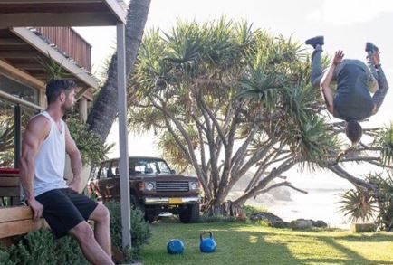 Kettlebell, Tree, Games, Bocce, Flip (acrobatic), Plant, Palm tree, Arecales, Lawn, Leisure,