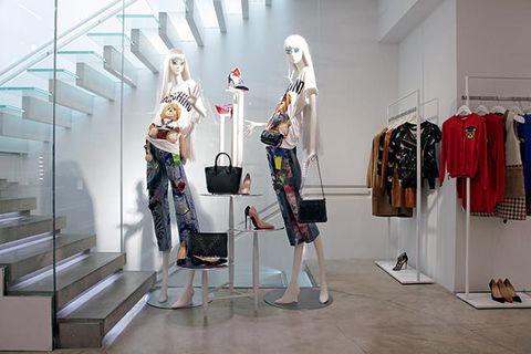 Stairs, Retail, Clothes hanger, Mannequin, Outlet store, Collection, Boutique, Fashion design, One-piece garment, Shelf,