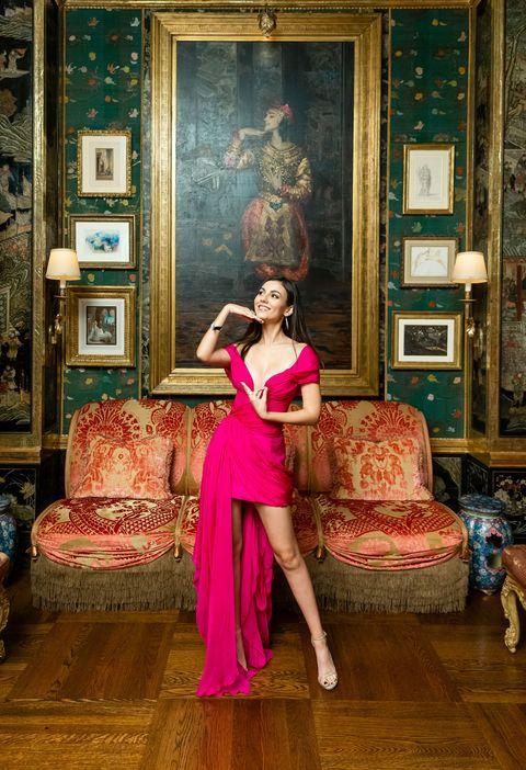 Pink, Clothing, Dress, Room, Furniture, Photo shoot, Formal wear, Long hair, Leg, Magenta,