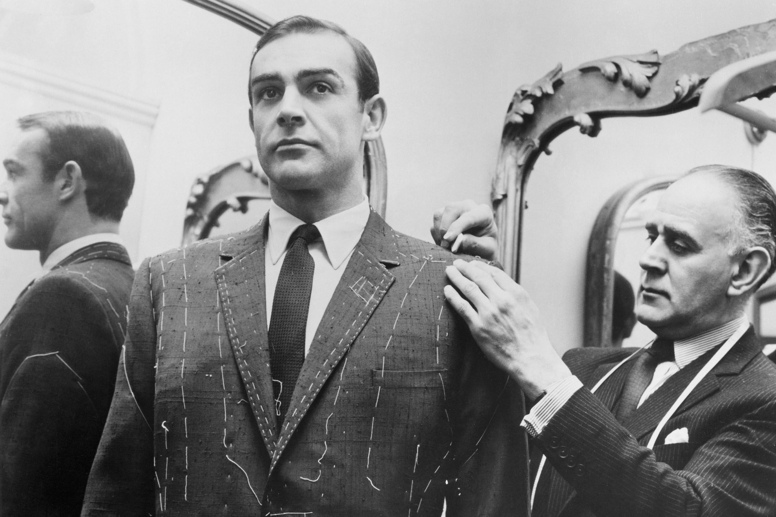 Tailor Anthony Sinclair fitting Sean Connery for one of the suits he will wear in the film From Russia With Love in Mayfair, London