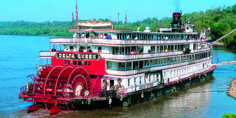 Delta Queen paddle wheel travelling on Mississippi river, USA