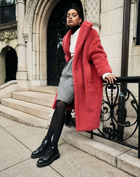 A model in a red fur coat