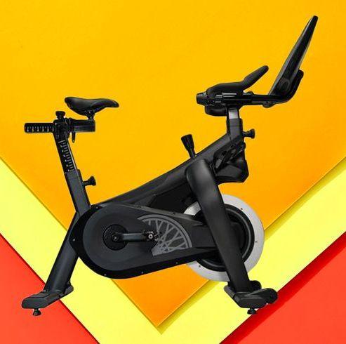 exercise machine, stationary bicycle, indoor cycling, exercise equipment, exercise, sports equipment, room, elliptical trainer, vehicle,