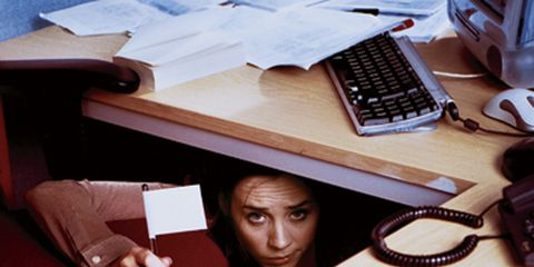 Take Time Off: Woman Under Desk