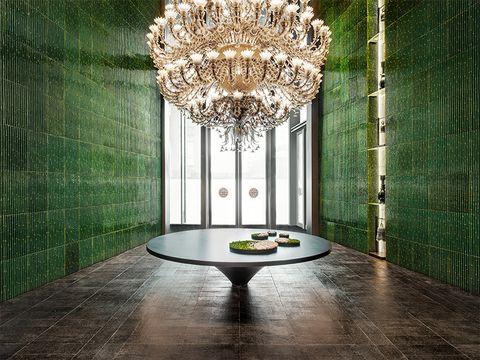 Floor, Interior design, Room, Green, Ceiling, Lighting, Table, Flooring, Furniture, Light fixture,