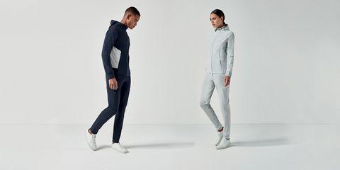 White, Clothing, Standing, Fashion, Sportswear, Suit, Footwear, Human, Sleeve, Outerwear,