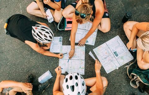 cyclists looking at a map