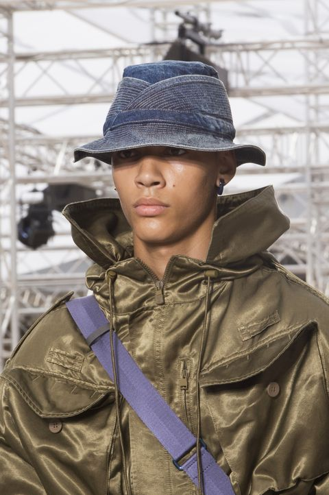 Fashion, Outerwear, Headgear, Jacket, Soldier, Hat, Photography, Fashion accessory, Military, Coat,