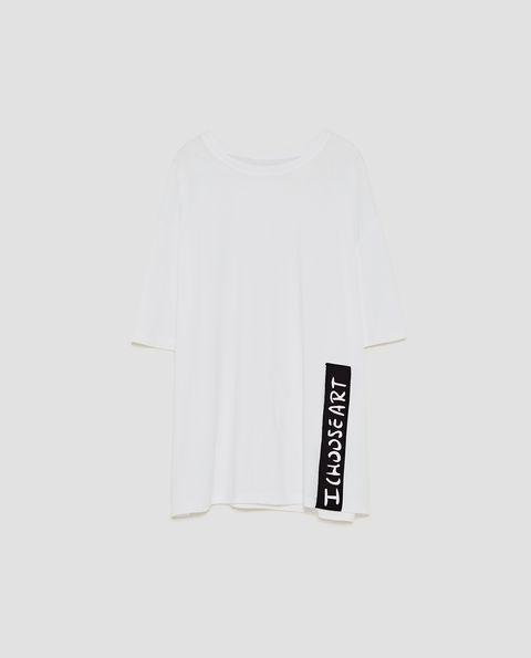 White, Clothing, T-shirt, Sleeve, Sportswear, Font, Neck, Logo, Jersey, Brand,