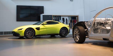 Land vehicle, Vehicle, Car, Sports car, Automotive design, Aston martin vantage, Supercar, Yellow, Performance car, Aston martin v8 vantage (2005),