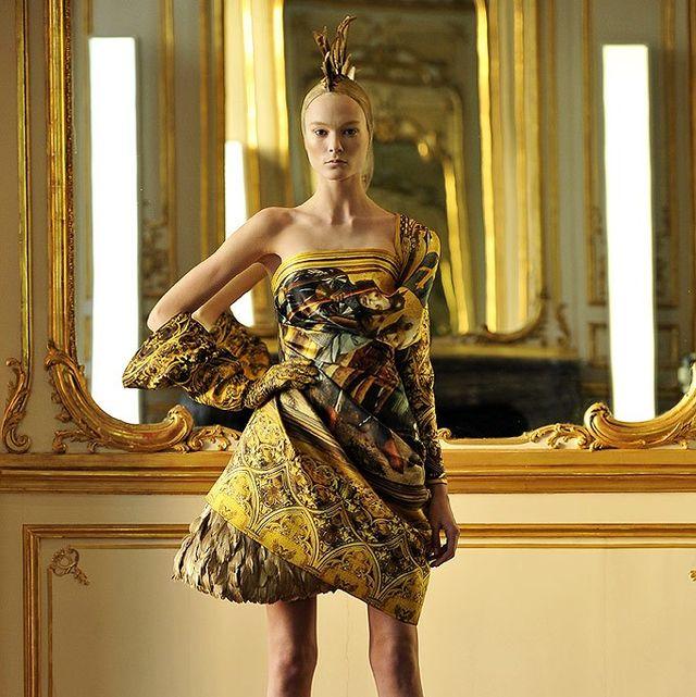 Fashion model, Dress, Clothing, Fashion, Shoulder, Haute couture, Cocktail dress, Yellow, Beauty, Fashion design,