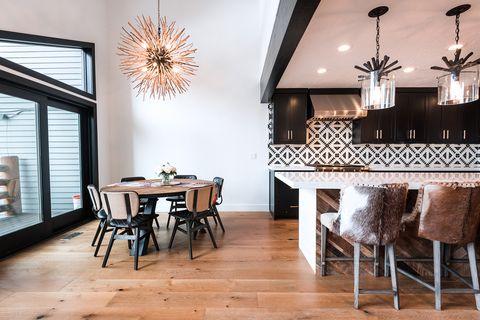 Room, Dining room, Interior design, Furniture, Floor, Property, Ceiling, Wood flooring, Table, Lighting,