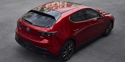 Land vehicle, Vehicle, Car, Automotive design, Red, Mid-size car, Motor vehicle, Hatchback, Mazda, Family car,