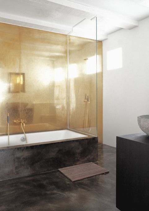 Bathroom with antique metal wall and black concrete floor