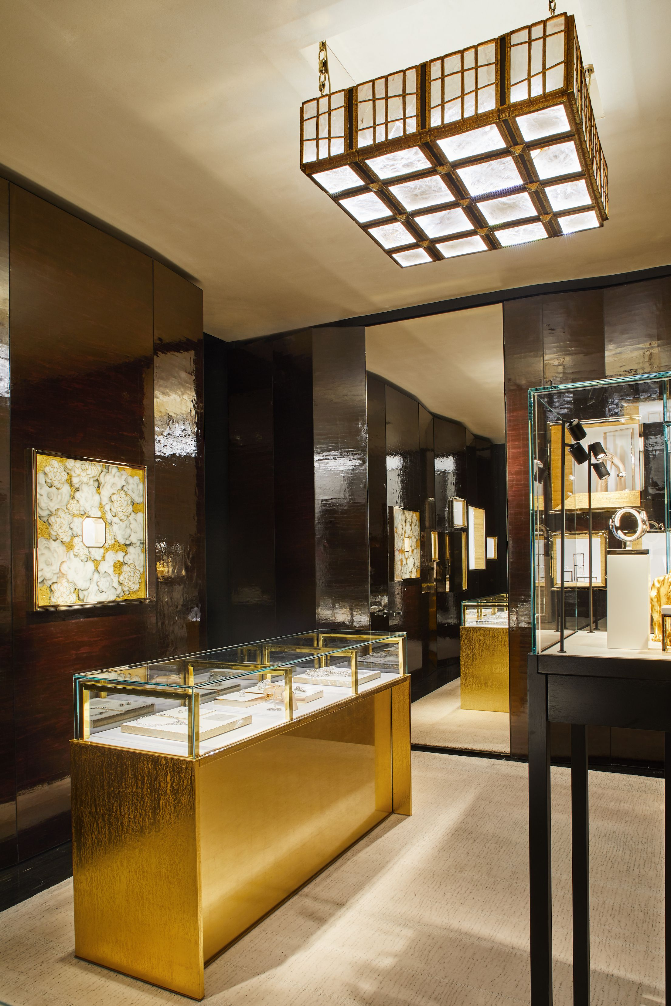 Marino chose gold leaf accents for the Watches and Fine Jewelry Salon as homage to the Coromandel screens that were in Gabrielle Chanel's Paris apartment on the rue Cambon.