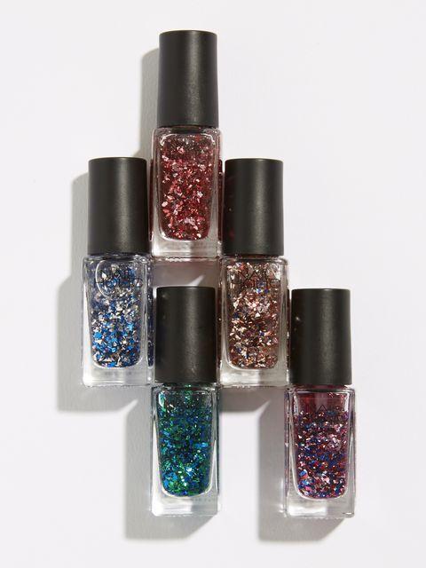 Nail polish, Glitter, Cosmetics, Nail care, Nail, Beauty, Fashion accessory, Material property, Liquid, Silver,