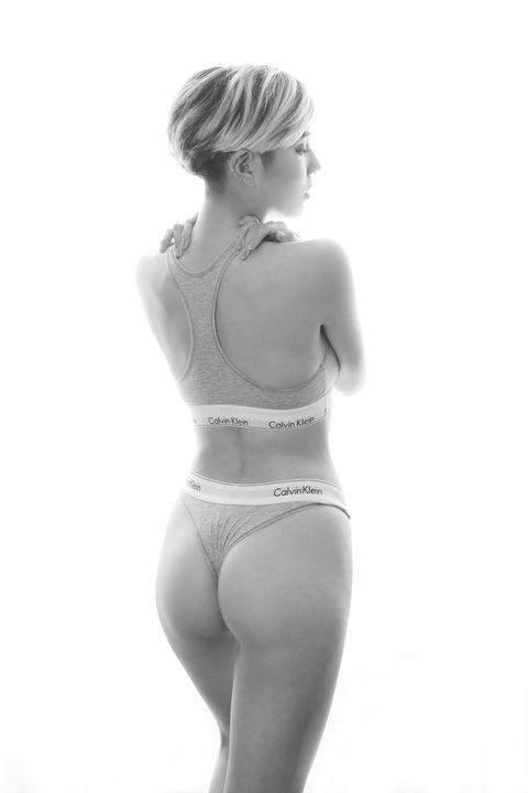 White, Clothing, Waist, Shoulder, Joint, Standing, Leg, Abdomen, Undergarment, Thigh,