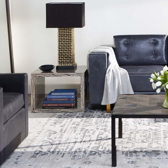Furniture, Living room, Coffee table, Room, Black, Table, Floor, Interior design, Wall, Tile,