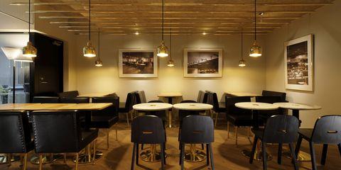 Building, Room, Interior design, Restaurant, Table, Café, Furniture, Architecture, Ceiling, Floor,