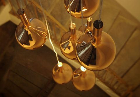 Amber, Brass, Metal, Bronze, Reflection, Still life photography, Transparent material, Circle, Natural material, Bronze,