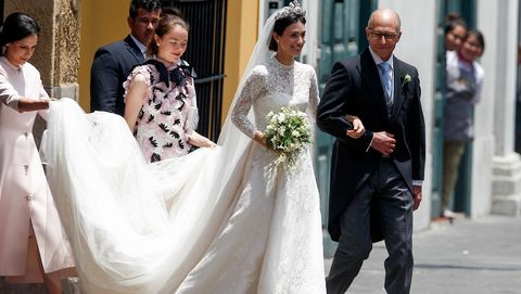 Wedding dress, Gown, Bride, Dress, Bridal clothing, Photograph, White, Facial expression, Marriage, Ceremony,