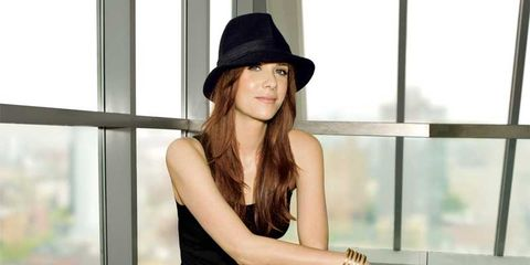 Interview with SNL's Kristen Wiig: Actress seated wearing hat