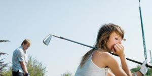 Relationship Advice: Couple with golf clubs