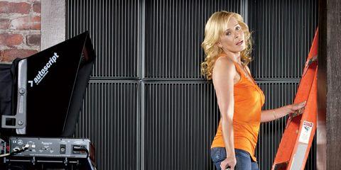 Comedian Chelsea Handler: In orange top on ladder