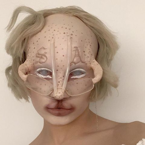 alien beauty, brows, bleached eyebrows, shaved eyebrows, extreme makeup, prosthetics, shocking