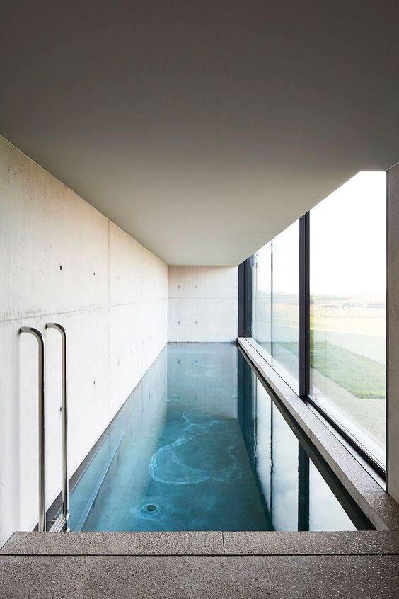 20 striking indoor swimming pool designs stylish indoor pool ideas rh housebeautiful com indoor swimming pool designs and prices indoor swimming pool design considerations