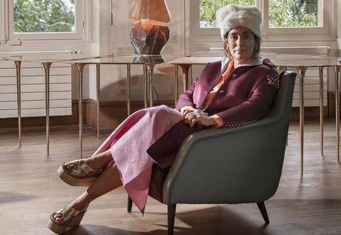 Human body, Sitting, Room, Comfort, Floor, Furniture, Interior design, Flooring, Fixture, Hardwood,