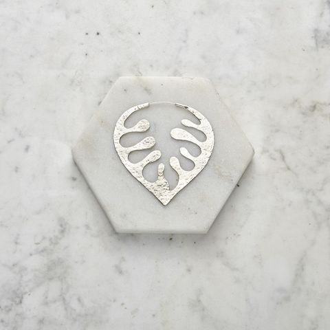 Font, Silver, String instrument accessory, Metal, Locket, Musical instrument accessory, Fashion accessory, Guitar accessory, Emblem, Logo,