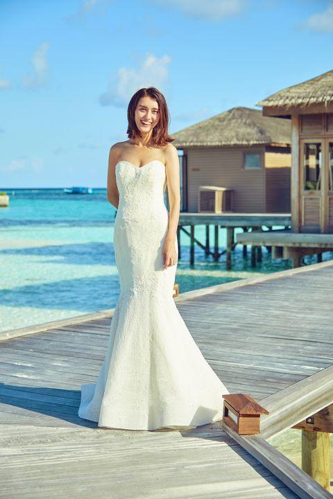 Wedding dress, Gown, Dress, Clothing, Photograph, Bridal clothing, White, Bride, Shoulder, Bridal party dress,