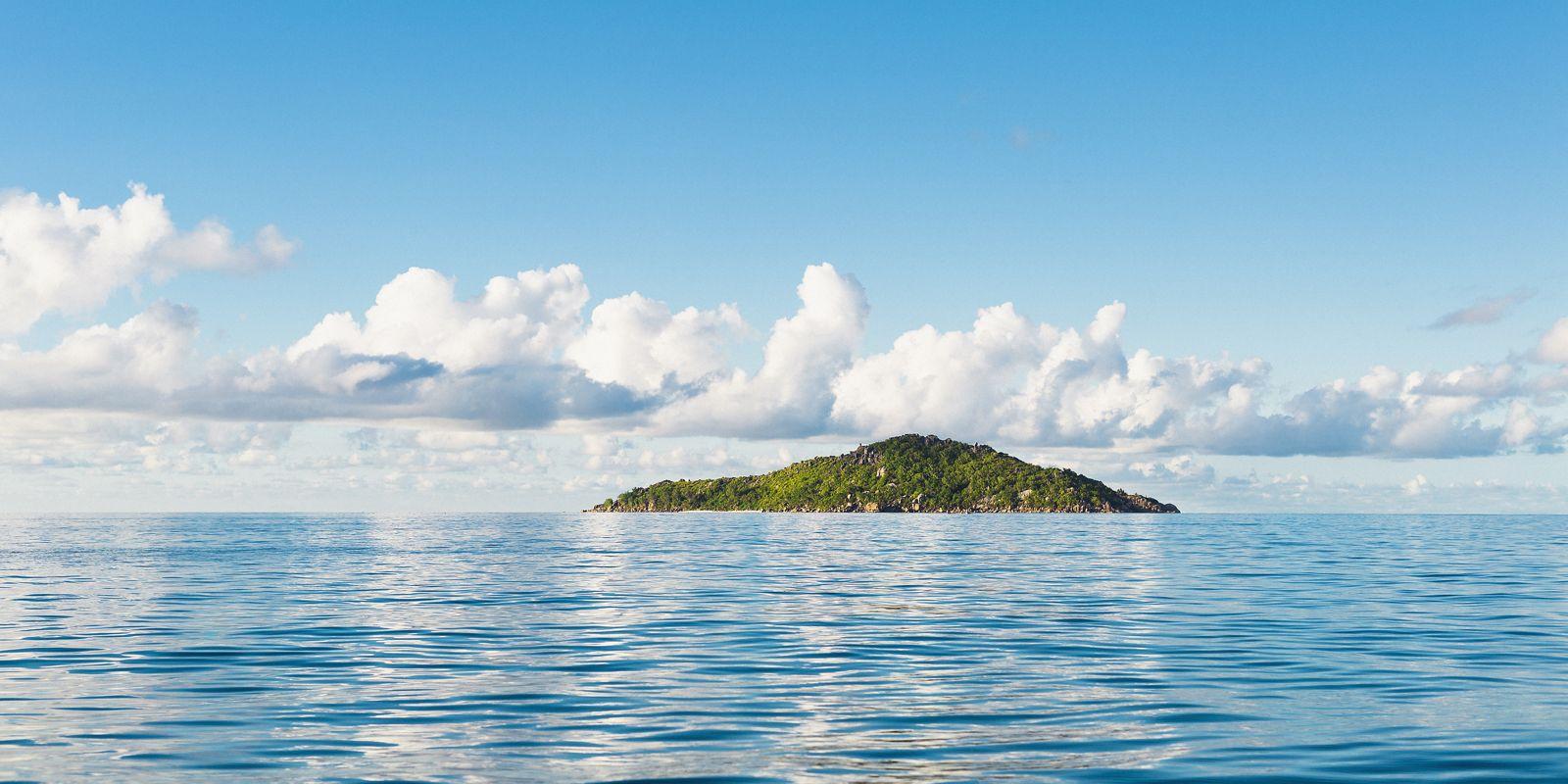 Scenic view of seascape against blue sky, Island of Petite Soeur, Seychelles