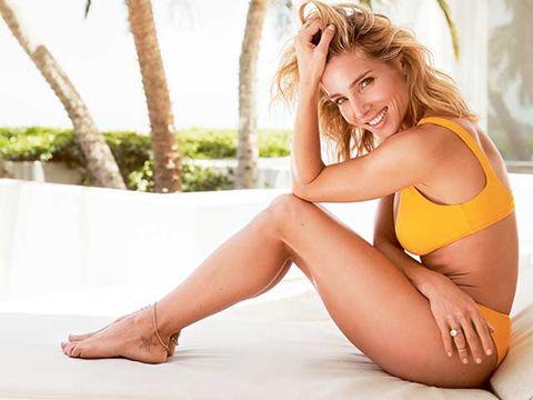 Leg, Blond, Skin, Human leg, Thigh, Beauty, Sitting, Model, Stomach, Human body,